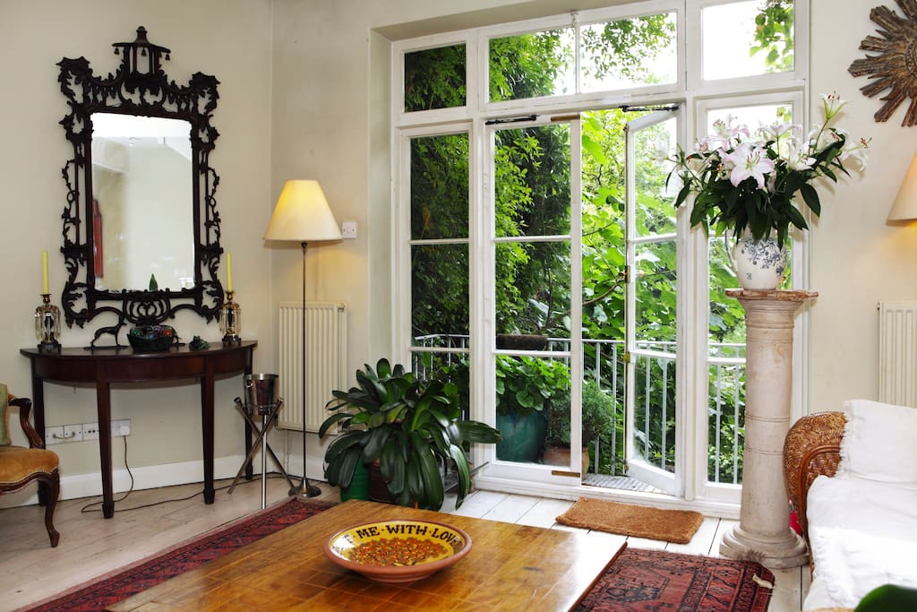 Beautiful ground-floor sitting/dining area with french doors leading to the garden