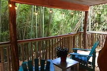 Large private porch of the treehouse is ringed in bamboo. You'll feel like you're in Bali.