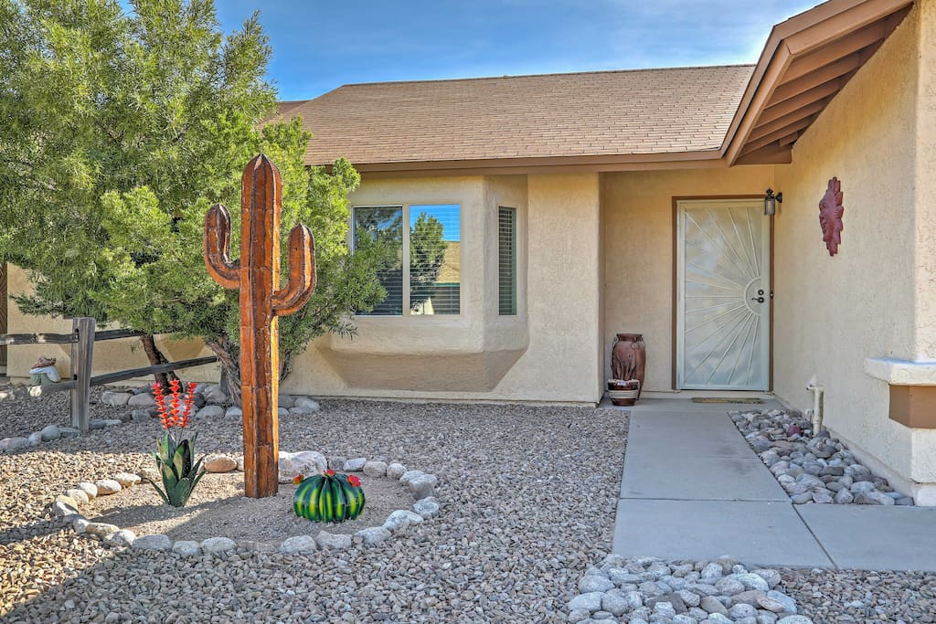 Upon arrival, a cactus invites you up to the Southwestern home.