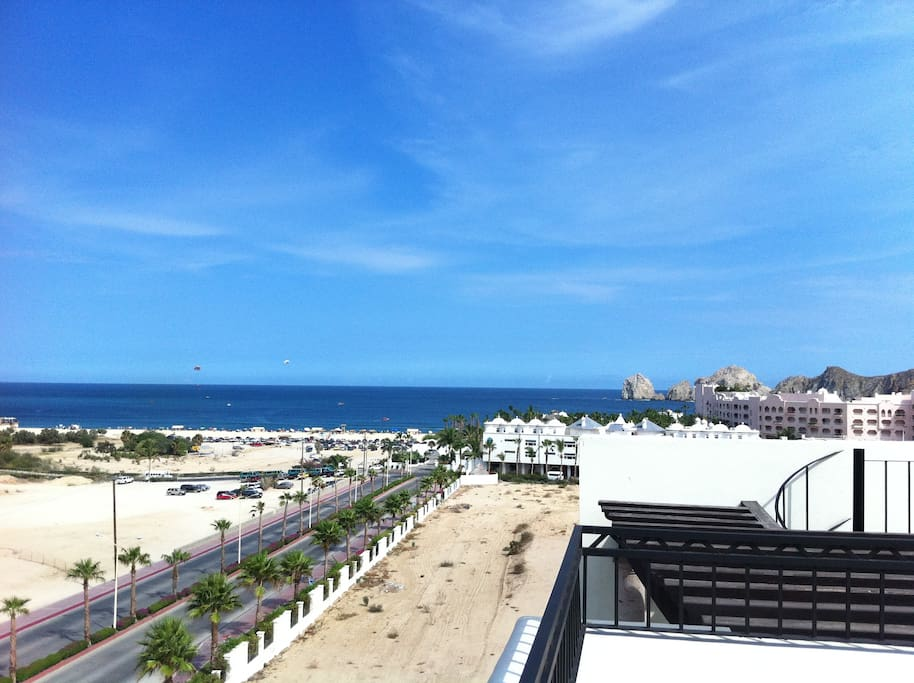 View of the Arches and main Cabo beach from private rooftop deck.