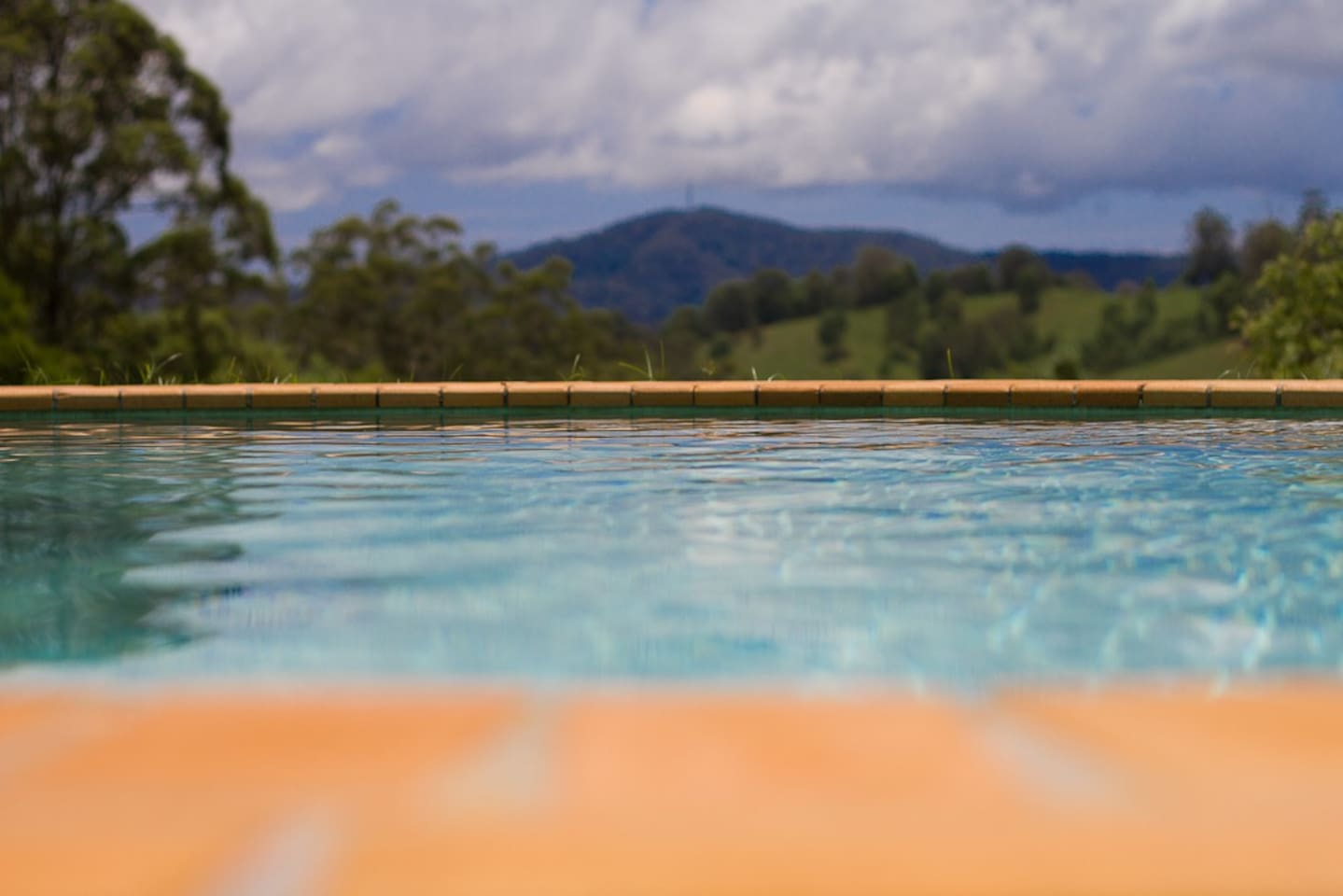 12m swimming pool with views into adjacent rural valley.