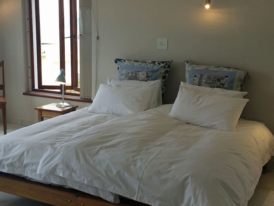 King size bed from the two single beds, with two 3/4 duvets