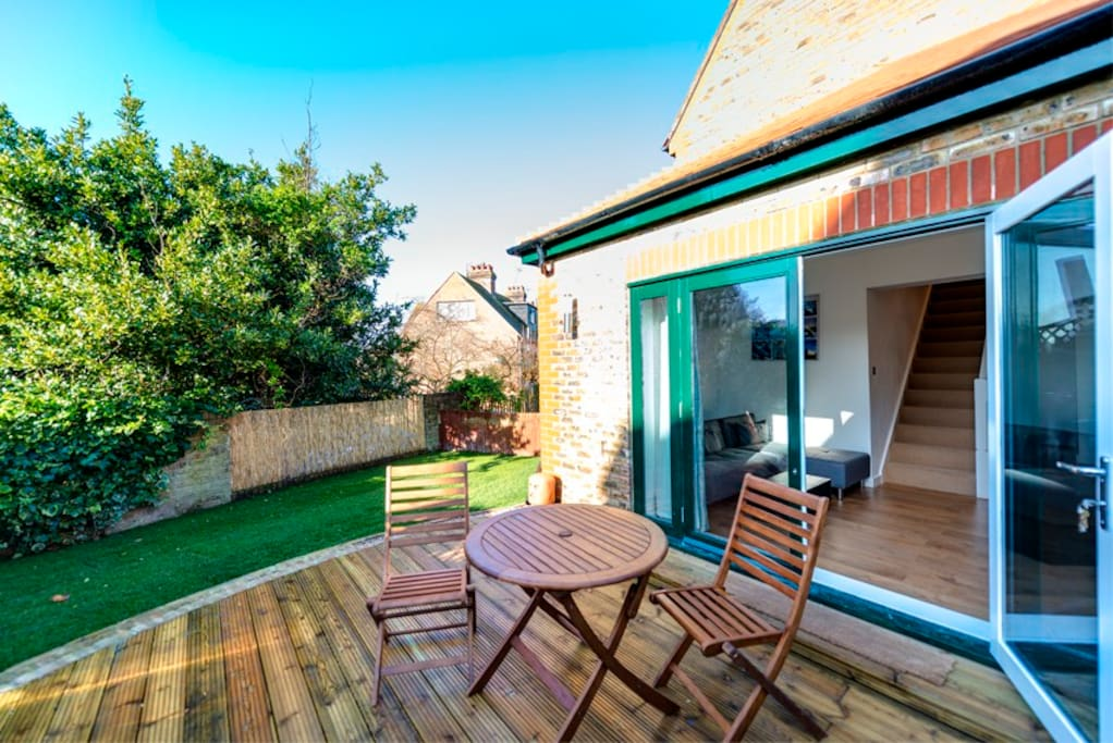 Living area leads out to the garden perfect for alfresco dining or a glass of Pimm's!