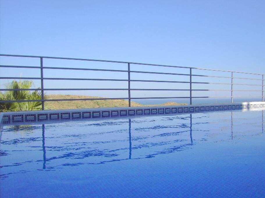 One pool and sea and countryside views.