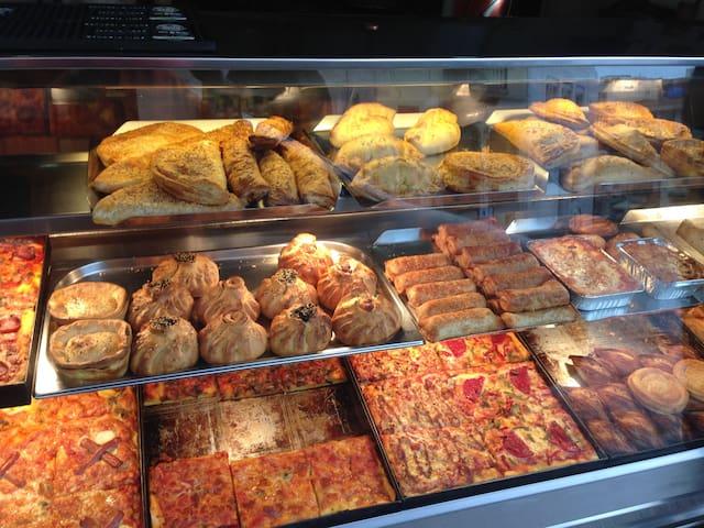 Champ's Take-away shop, Mellieha. Pastizzi, pizza, pies, lasagna, sausage rolls, Tuna bake at reasonable prices.