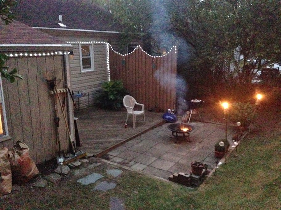 Our backyard with fire pit and BBQ