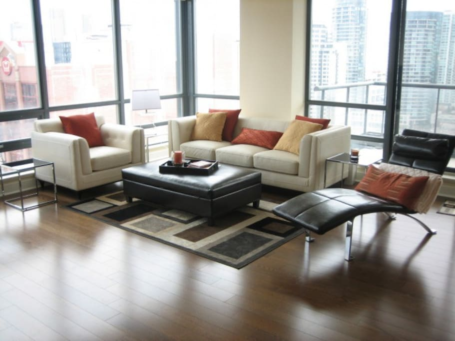 Fully furnished living room.  Floor to ceiling windows.