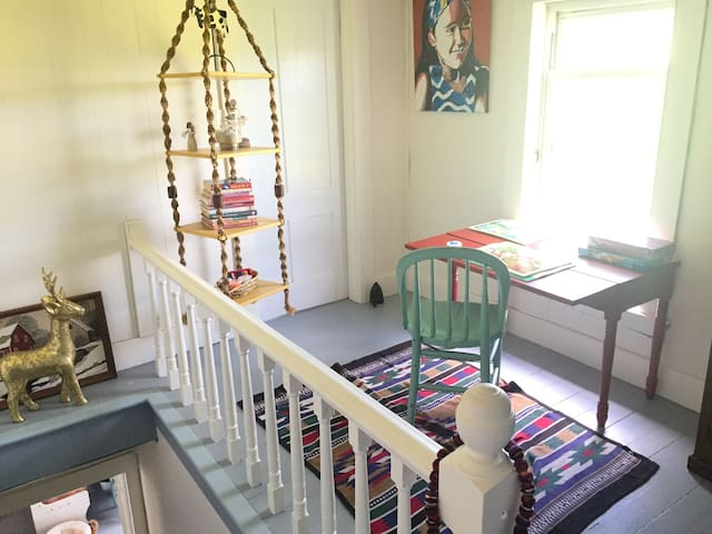 The landing at the top of the stairs is a nice area to sit and enjoy puzzles & games & take in the views of the meadows, mountains & maple sugar bush.