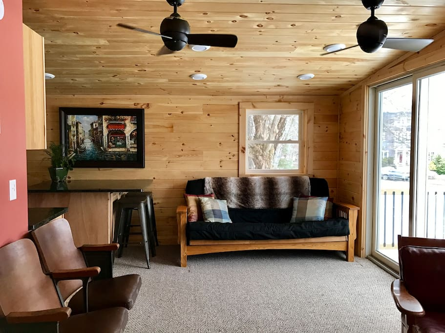 Comfortable living room area with fold out futon couch if needed