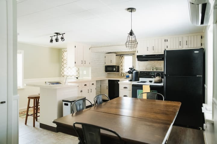The kitchen is fully stocked with all the essentials for your stay. We also offer a leaf for the farmhouse dining table and two additional chairs, if needed.