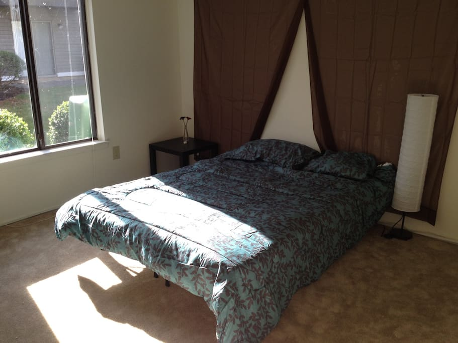 bedroom with platform queen bed