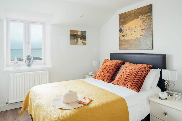 Second double bedroom with sea views