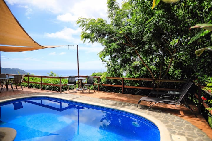 The spacious pool deck and lounge area also has the amazing world class view surrounded by beautiful gardens!