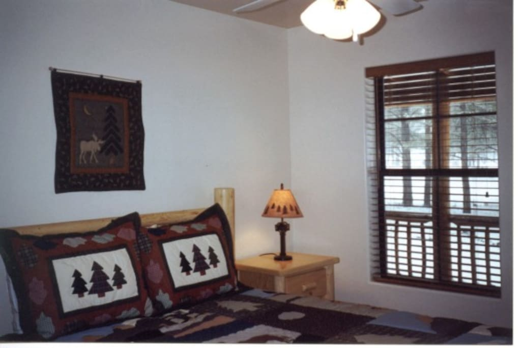 Lodge Pole Queen Beds in both Bedrooms of the Bar-S vacation rental cabin.