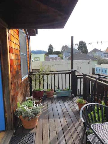 Room looks onto deck.  The garden is down the stairs.