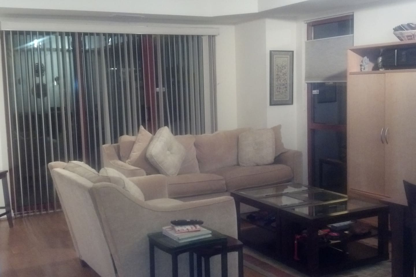 Beautiful living room in this corner unit for you to socialize and relax.