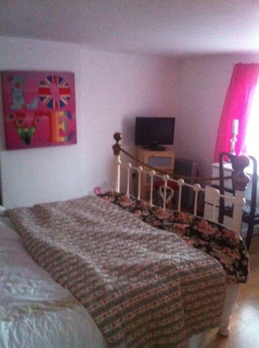TV and desk in the attic room