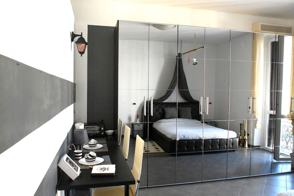 bedroom with double bed,wine cooler,  TV, kettle, minioven, AC