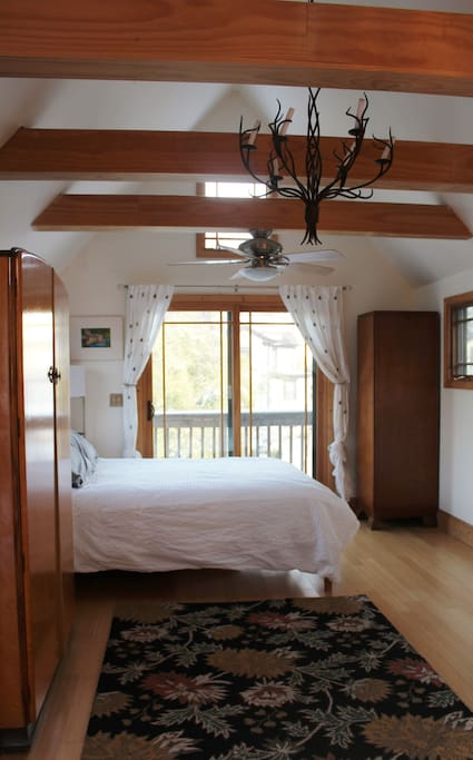 Bedroom/top floor of cottage. Enjoy privacy with light in your private hidden cottage in the center of Charlottesville!