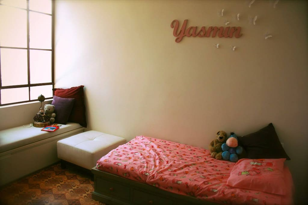 The second bedroom  - it has two beds, one queen size and this