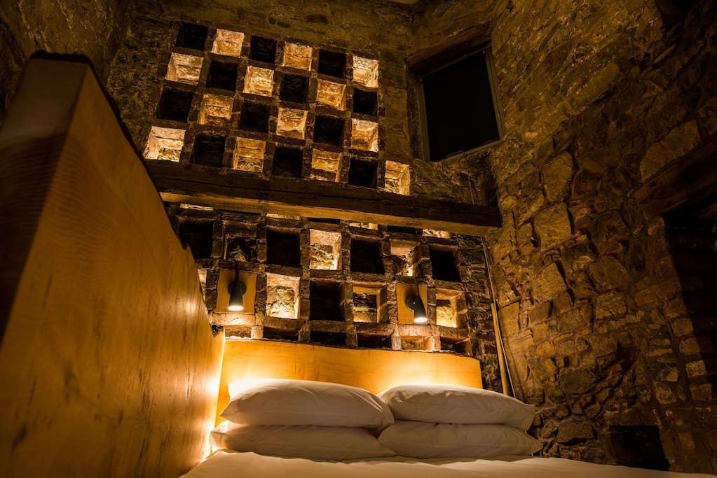 Bedroom at night. Illuminated former nesting-boxes.