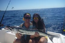 Honeymooners enjoy a day together and catch a big one