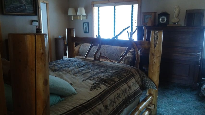 Master room, our largest room with a queen sized bed and couch. Couch can sleep another guest if you desire. This room has its own private entrance with attached bathroom and microwave. We also have an adjacent room with two twin beds available.