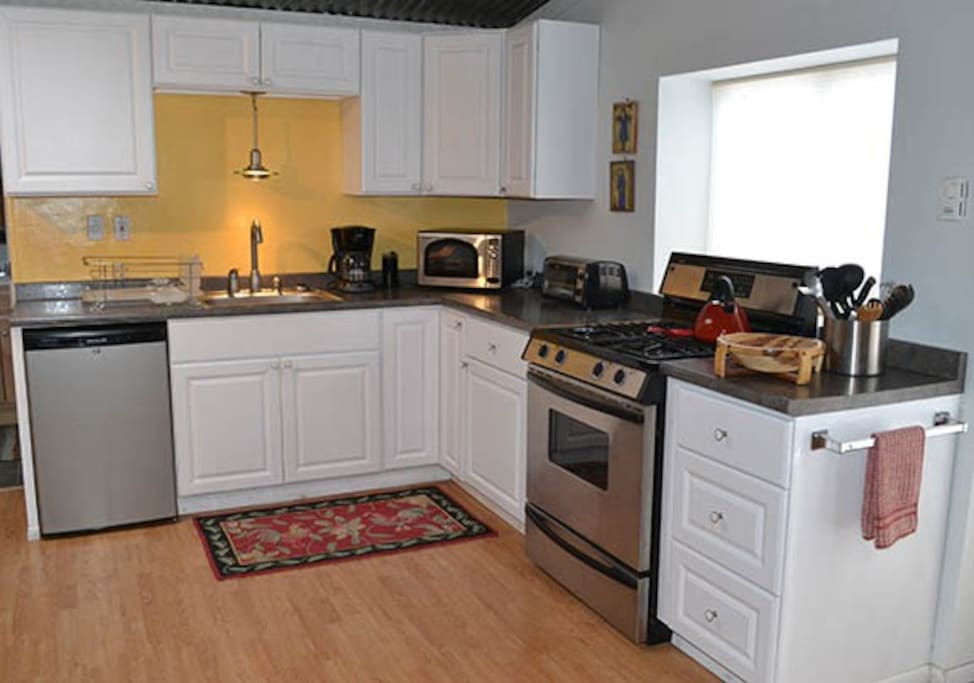 kitchen is stocked with plenty of spices, pots and pans, utencils and dinnerware for up to 6 people