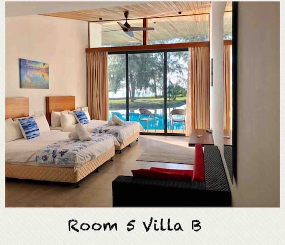 Room 5 with 2 queen size beds and views of the pool, lake and sea
