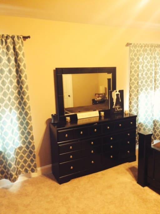 Dresser and windows of master bedroom.