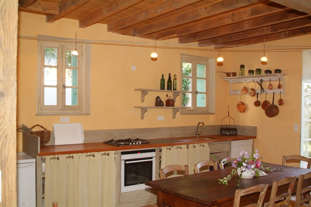 Country French kitchen with stove top, oven, dishwasher and fridge