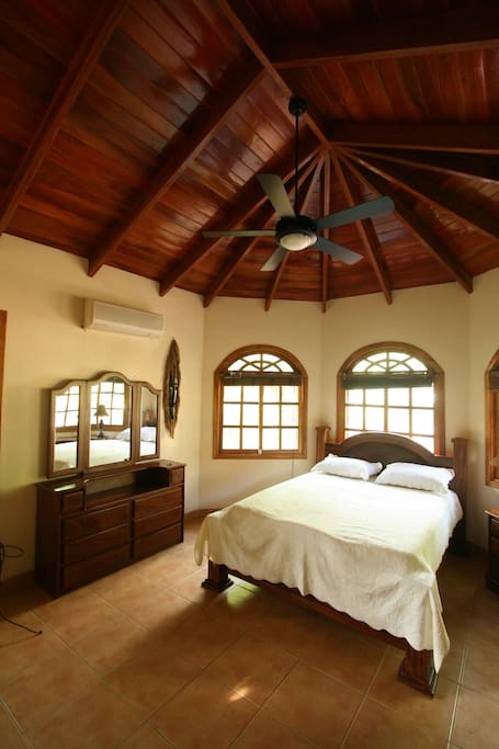 The master bedroom with queen size bed and private bathroom.