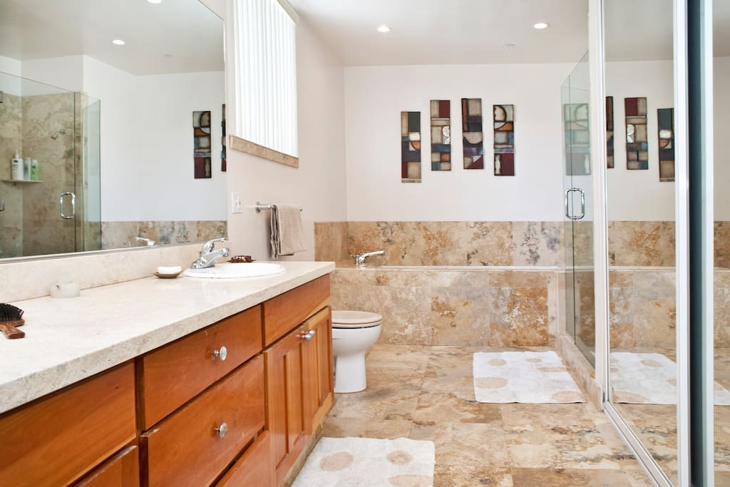 Bathroom with dual-sink, dual-shower head, and jacuzzi tub