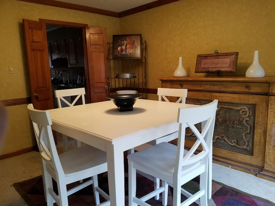 Dining room with bistro table opens to kitchen with eat-in dining