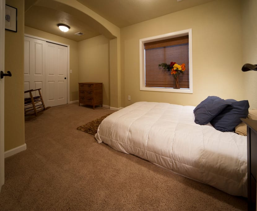 Bedroom has queen size Sleep-By-Number bed, small dresser, nice sized closet, rocking chair