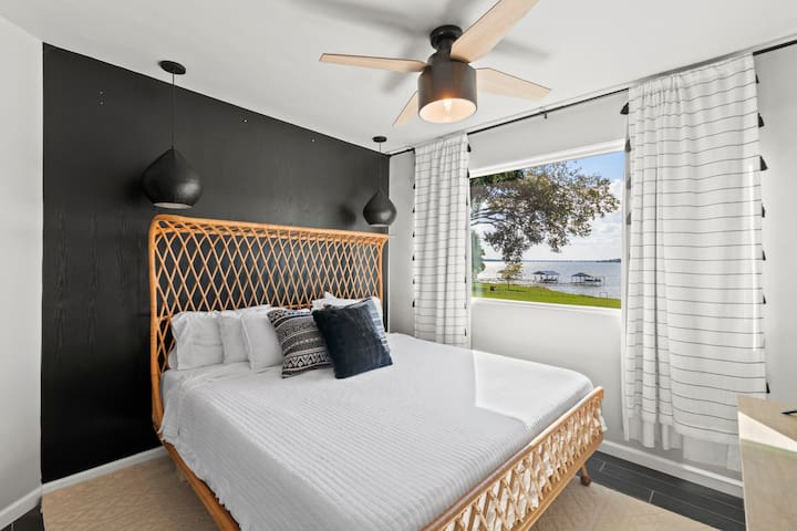 King sized memory foam bed. Incredible master suite with lake views and attached, private bathroom.
