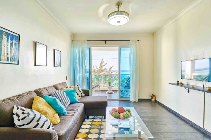 Living room with light/fan/bluetooth speaker and ocean views