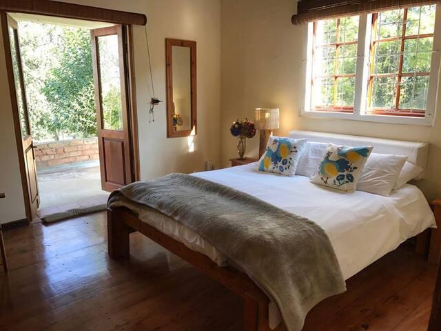 Hillside Country Lodge features beautiful yellow-wood floors and ceilings, three modern bathrooms, four double bedrooms each opening onto the verandah