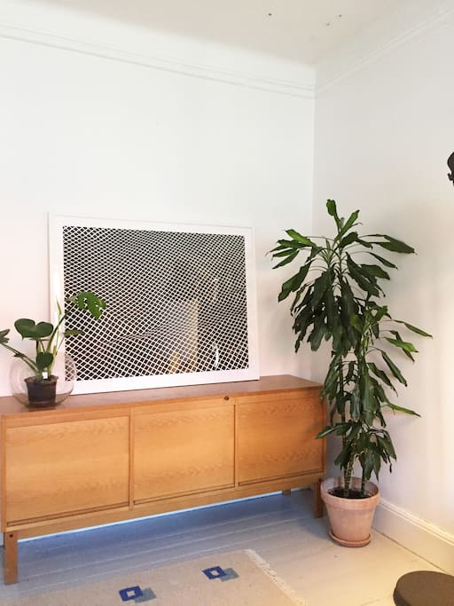 The bedroom with art work and plants :)