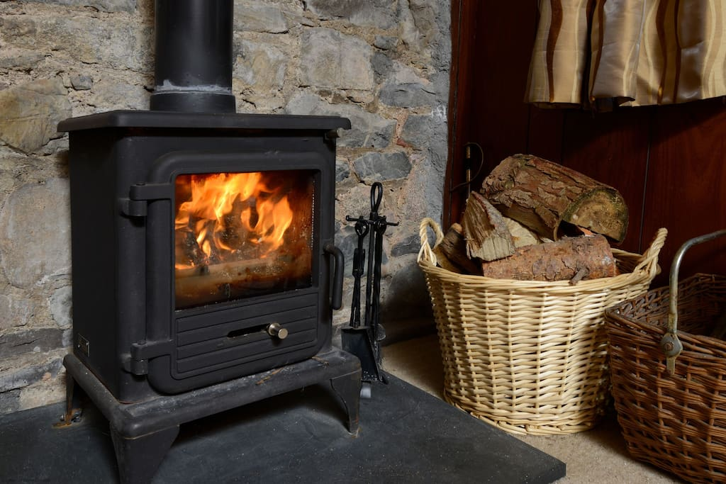 The Mews has a woodburning stove for cozy evenings in by the fire