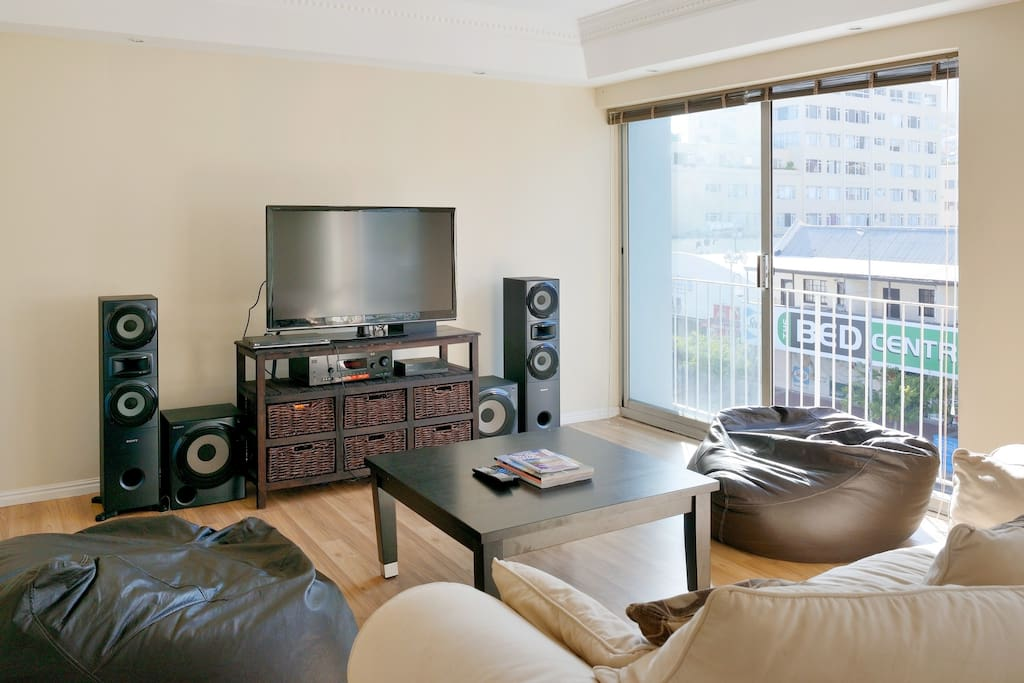 Lounge Area with Flat Screen TV, Apple TV and Sound System