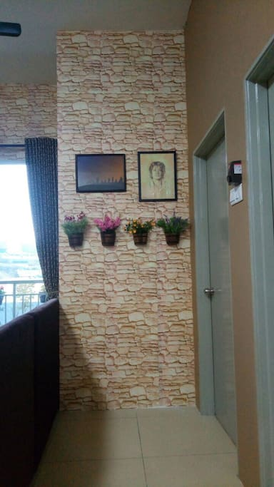 Walls designed to give a cosy and home like atmosphere, to welcome everyone.