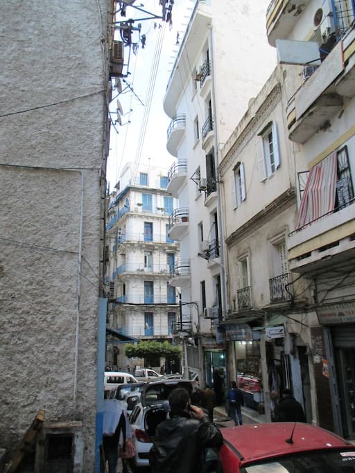 Top floor flat block at end with blue shutters - picture taken from local market, fish, fruit, olives, vegetables, fruit, fresh bread...
