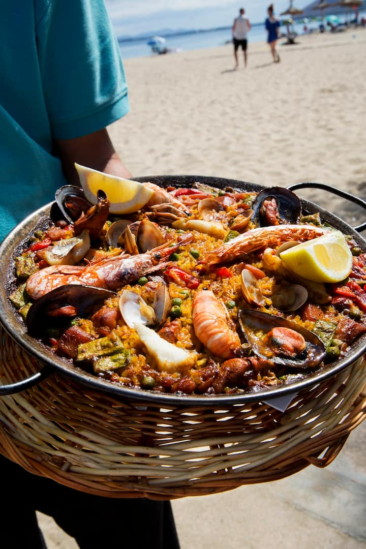 Image result for beach cooking paella