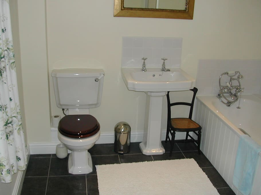 Kingsize bedroom's ensuite bathroom has a walk in shower and also a bath with shower