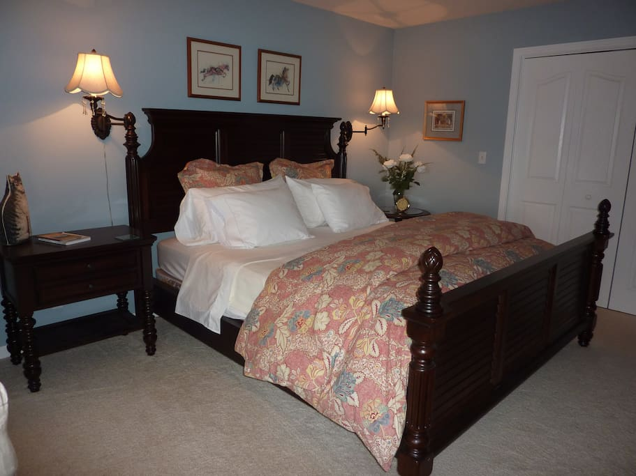 Inviting Cal King bed with sumptuous linens