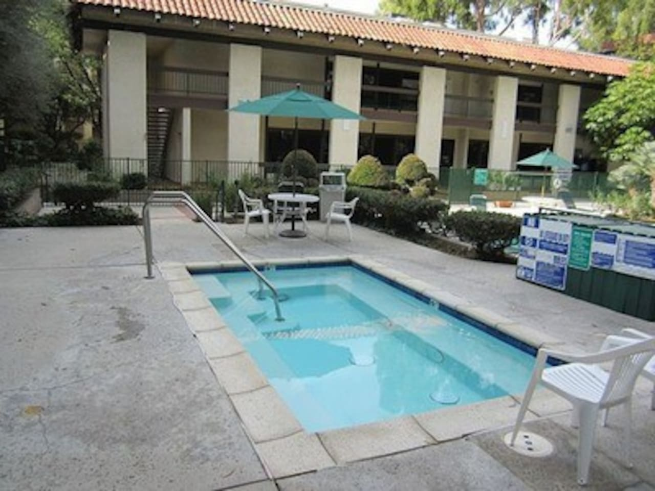 include lush grounds, good size pool and spa, tennis courts,