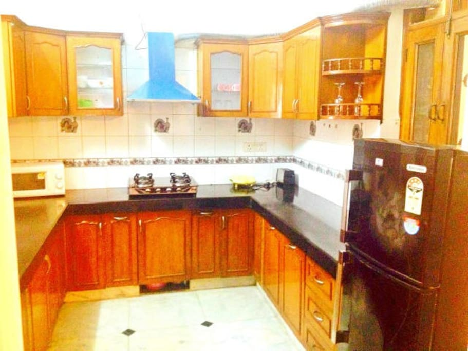 Fully equipped Kitchen with Gas, Refrigerator, Microwave, Cookware, etc.