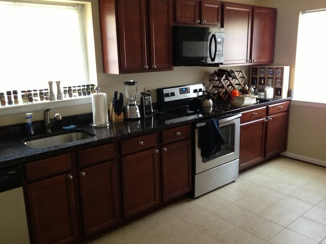 Full access to kitchen with new appliances (dishwasher, range/oven, refrigerator, and microwave)