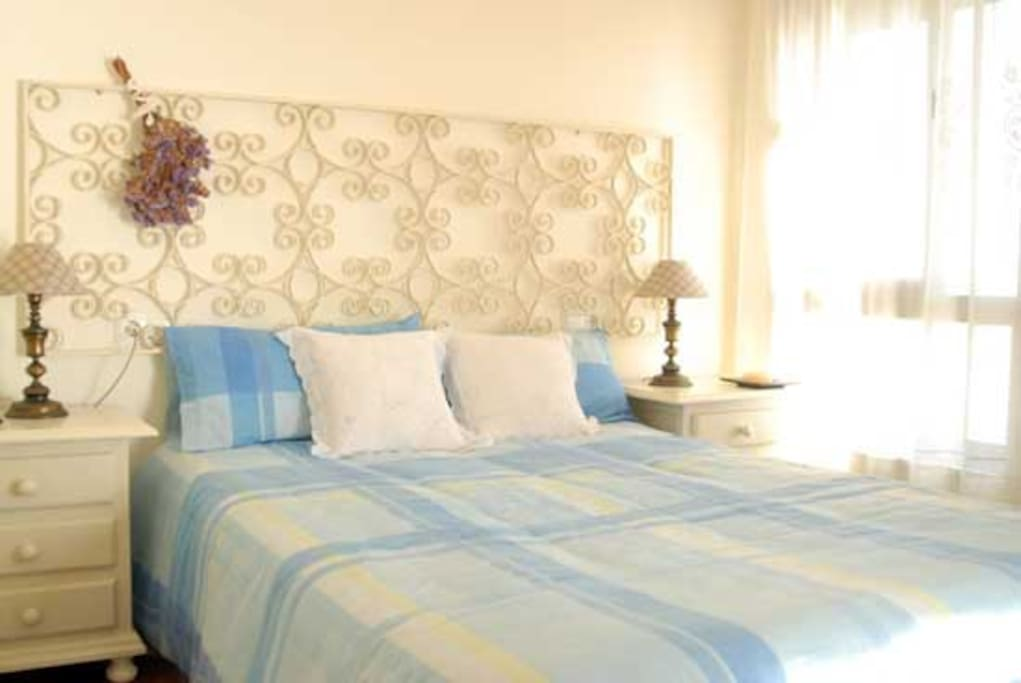 Main room with double bed and next to the window where you can see the sunrise.It also have acces to the balcony